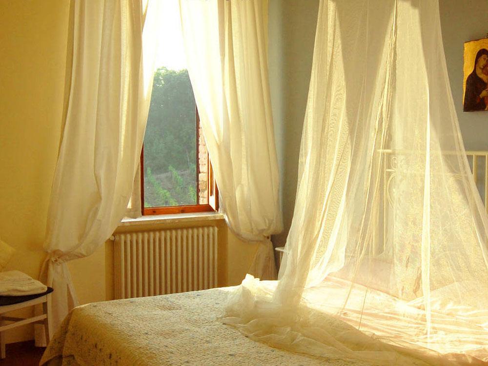 agriturismo casoledelsa siena toscana appartamento pinolo camera baldacchino